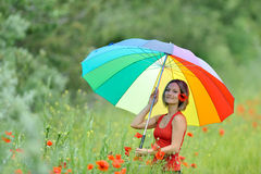 Young beautiful woman on cereal field in summer Royalty Free Stock Images