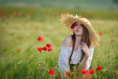 Young beautiful woman on cereal field in summer Stock Photos
