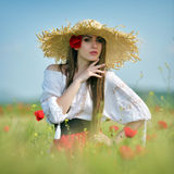Young beautiful woman on cereal field in summer Stock Images