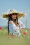 Young beautiful woman on cereal field in summer Stock Photography
