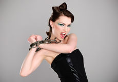 Young beautiful woman with chain and makeup Royalty Free Stock Image
