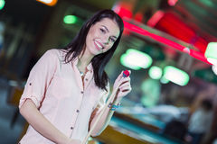 Young beautiful woman chalking the snooker cue and smiling Royalty Free Stock Photo