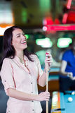 Young beautiful woman chalking the snooker cue and smiling Stock Photos