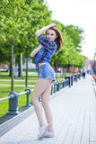 Young beautiful woman in a checkered blue shirt Stock Images