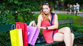 Young beautiful woman checking the shopping bags. Stock Images