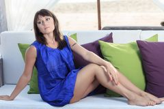 Woman sits back relaxed royalty free stock photography