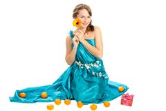 Young beautiful woman with a Christmas gift. Royalty Free Stock Image
