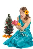 Young beautiful woman with a Christmas gift. Stock Images