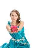 Young beautiful woman with a Christmas gift. Stock Photography