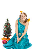 Young beautiful woman with a Christmas gift. Stock Image