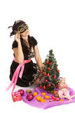 Young beautiful woman with a Christmas gift. Stock Photos