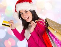Young beautiful woman, Christmas shopping. Royalty Free Stock Images