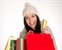 Young beautiful woman, Christmas shopping. Stock Photos