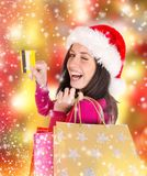 Young beautiful woman, Christmas shopping. Royalty Free Stock Photography