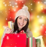 Young beautiful woman, Christmas shopping. Royalty Free Stock Photos
