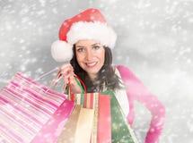 Young beautiful woman, Christmas shopping. Stock Photo