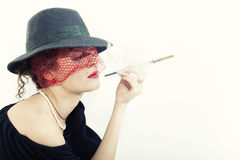 Young beautiful woman with cigarette Royalty Free Stock Photo