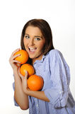 Young beautiful woman with citrus orange fruit Royalty Free Stock Photography