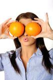 Young beautiful woman with citrus orange fruit Stock Images
