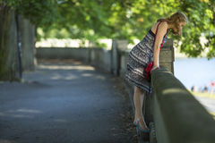 Young beautiful woman in the city Park. Walking. Stock Image