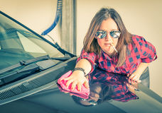 Young beautiful woman cleaning her Car at Carwash Royalty Free Stock Photography