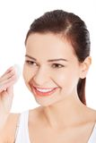 Young beautiful woman cleans the eye make-up Royalty Free Stock Photo