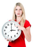 Young beautiful woman with the clock Stock Image