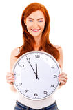 Young beautiful woman with the clock isolated in white Royalty Free Stock Images
