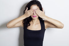 Young beautiful woman closing her eyes with hands Royalty Free Stock Image
