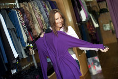 Young beautiful woman in clothes store. Stock Photography
