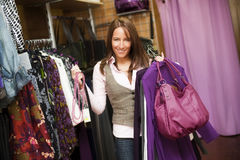 Young beautiful woman in clothes store. Stock Photos