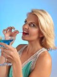 Young beautiful woman with cocktail on a blue background Stock Image
