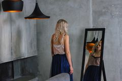 Young beautiful woman near mirror. Royalty Free Stock Photo