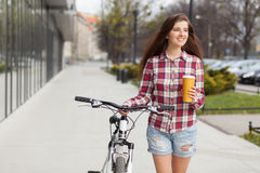 Young beautiful woman with coffee cup and a Royalty Free Stock Photo