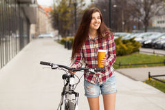 Young beautiful woman with coffee cup and a Stock Photo