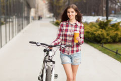 Young beautiful woman with coffee cup and a Stock Images