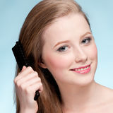 Young beautiful woman with comb Royalty Free Stock Photo