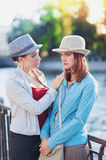 Young beautiful woman comforting her friend in the city Royalty Free Stock Photo