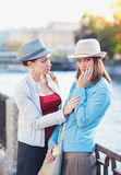 Young beautiful woman comforting her friend in the city Royalty Free Stock Images