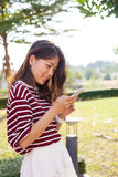 Young beautiful woman connecting by chat and reading message in Royalty Free Stock Images