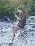 Young beautiful woman connecting people by smart phone on sea si Stock Photos