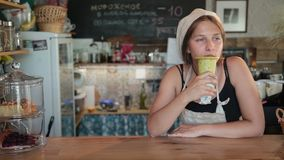 Young beautiful woman cook enjoying the meal stock footage