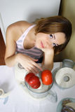 Young beautiful woman cooking Royalty Free Stock Photos