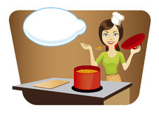 Young beautiful woman cooking in the kitchen Royalty Free Stock Photography
