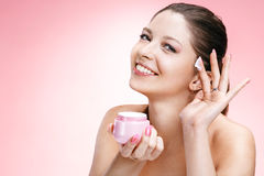 Young beautiful woman with cosmetic cream Royalty Free Stock Image