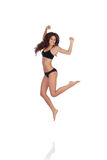 Young beautiful woman in cotton underwear jumping Stock Photo