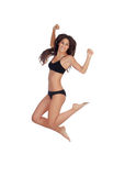Young beautiful woman in cotton underwear jumping Stock Image