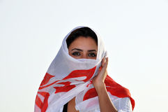 Young beautiful woman covered with scarf Stock Image