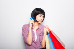 Young beautiful woman with credit card and shopping bags Stock Photos