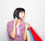 Young beautiful woman with credit card and shopping bags Royalty Free Stock Photos